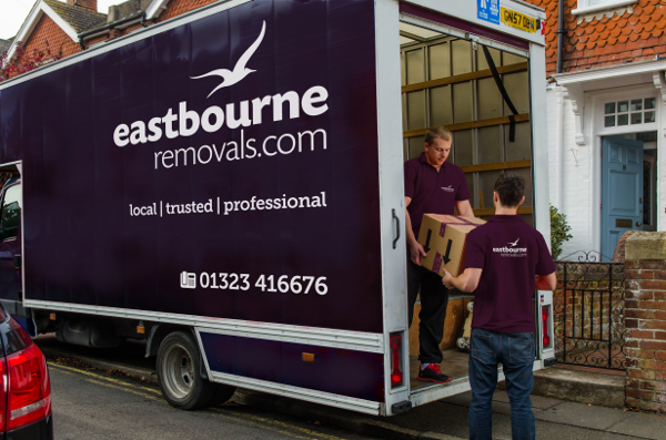 movers unloading removals boxes from a van